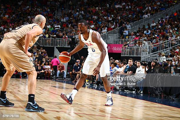 Harrison Barnes of the USA Basketball Men's National Team dribbles the ball against Manu Ginobili of Argentina on July 22 2016 at TMobile Arena in...