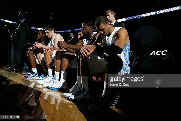 Harrison Barnes Tyler Zeller James Michael McAdoo Reggie Bullock and Kendall Marshall of the North Carolina Tar Heels sit on the bench during pregame...