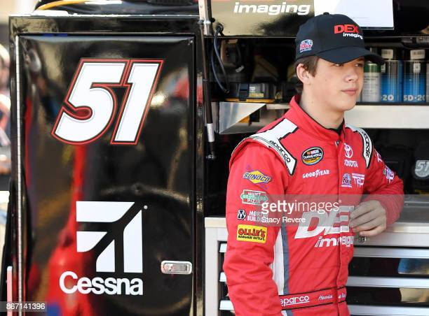 Harrison Burton driver of the DEX Imaging Toyota stands in the garage area during practice for the NASCAR Camping World Truck Series Texas Roadhouse...