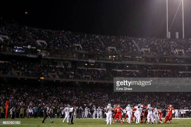 Harrison Butker of the Kansas City Chiefs kicks a field goal against the Oakland Raiders during their NFL game at OaklandAlameda County Coliseum on...