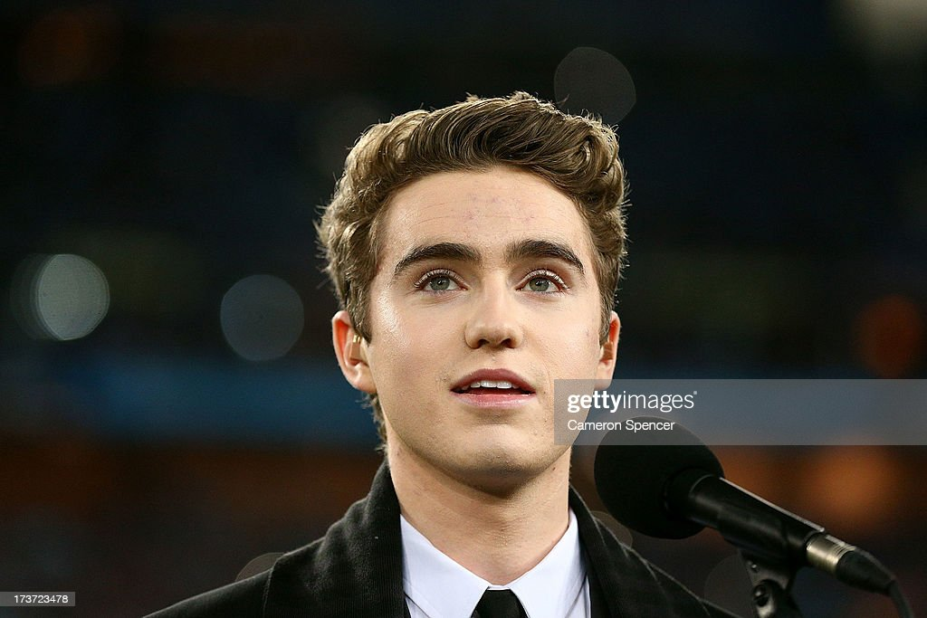 Harrison Craig sings the national anthem before game three of the ARL State of Origin series between the New South Wales Blues and the Queensland Maroons at ANZ Stadium on July 17, 2013 in Sydney, Australia.