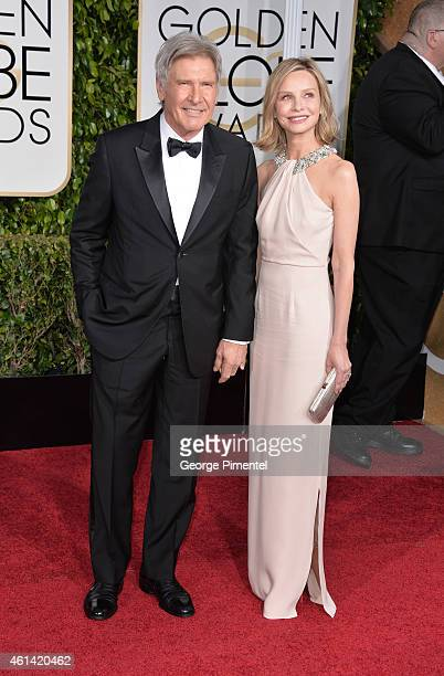 Harrison Ford and Calista Flockhart attend the 72nd Annual Golden Globe Awards at The Beverly Hilton Hotel on January 11 2015 in Beverly Hills...