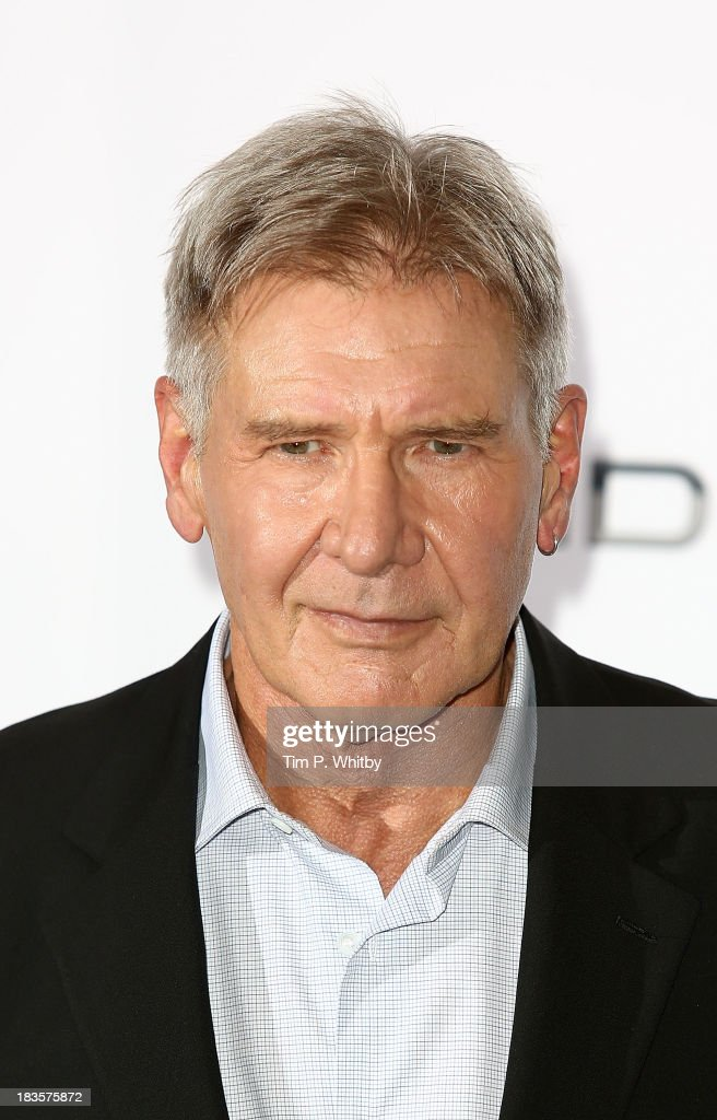 Harrison Ford attends a photocall to promote 'Ender's Game' at Odeon Leicester Square on October 7, 2013 in London, England.