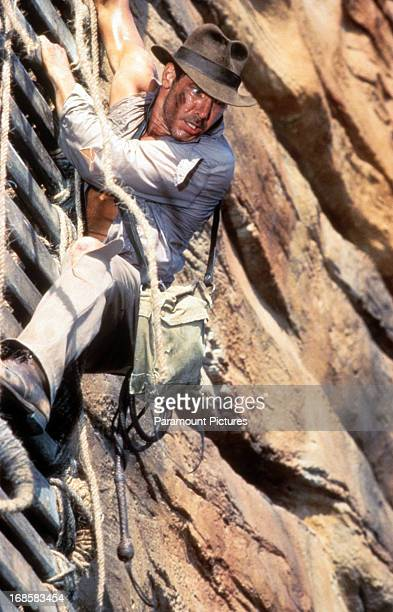 Harrison Ford descends down a cliff in a scene from the film 'Indiana Jones And The Temple Of Doom' 1984