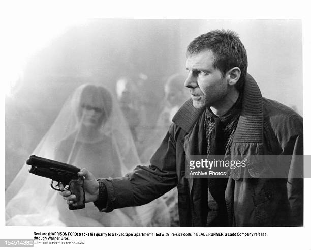 Harrison Ford holds a gun in a scene from the film 'Blade Runner' 1982