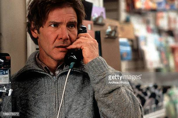 Harrison Ford on pay phone in a scene from the film 'The Fugitive' 1993