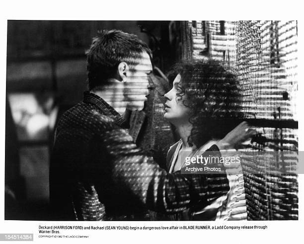 Harrison Ford prepares to kiss Sean Young in a scene from the film 'Blade Runner' 1982