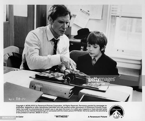 Harrison Ford questions Lukas Haas in a scene from the Paramount Pictures movie 'Witness' circa 1985