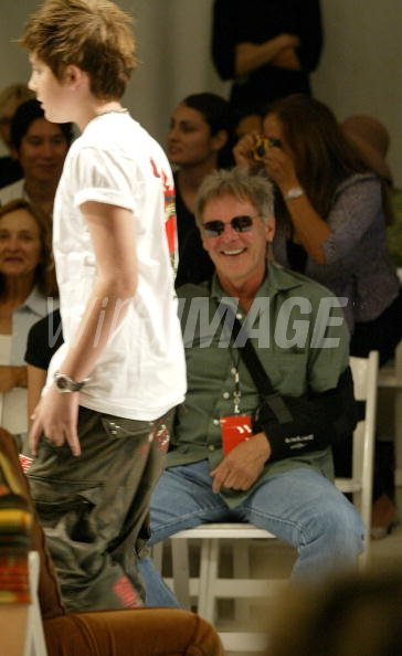 Harrison Ford watches son Malcolm Ford on the runway in the 2B Free