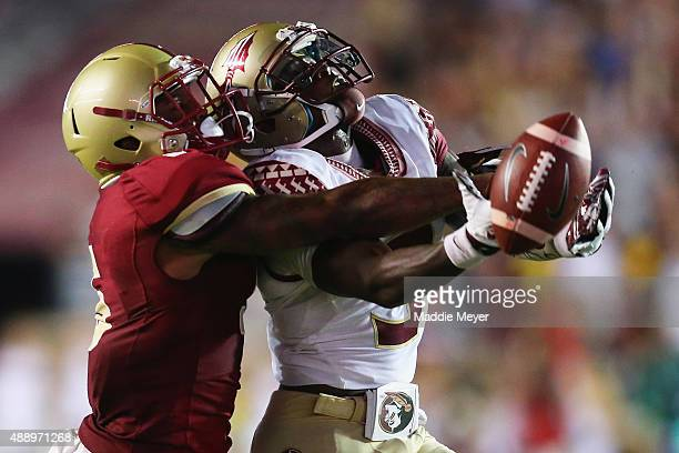 Harrison Jackson of the Boston College Eagles blocks a pass to Da'Vante Phillips of the Florida State Seminoles at Alumni Stadium on September 18...