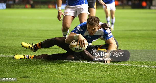 Harrison Keddie of Newport Gwent Dragons dives over Christian Wade to score the match winning try in the final against Wasps during the Singha...