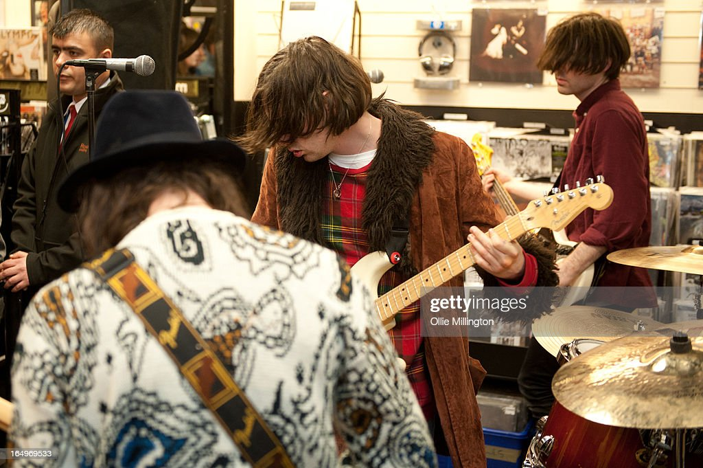 Harrison Koisser and Sam Koisser of Peace perform during an instore gig at Head Records to promote the release of their debut album 'In Love' on March 29, 2013 in Leamington Spa, England.