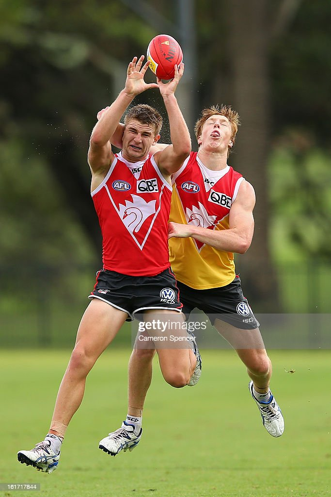 Harrison Marsh of the Swans takes a mark in front of Matthew Dick of the Swans during an intra-club practice match during a Sydney Swans AFL training session at Moore Park on February 15, 2013 in Sydney, Australia.