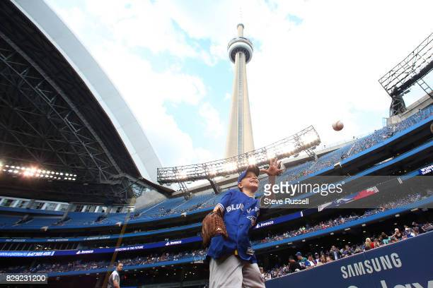 TORONTO ON AUGUST 9 Harrison Maye a 7yearold from PEI is a Hodgkin's Lymphoma survivor warms up before throwing out the ceremonial first pitch as the...