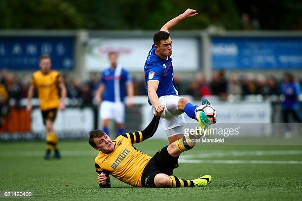 Harrison McGahey is challenged by Alex Flisher of Maidstone United during The Emirates FA Cup first round match between Maidstone United and Rochdale...