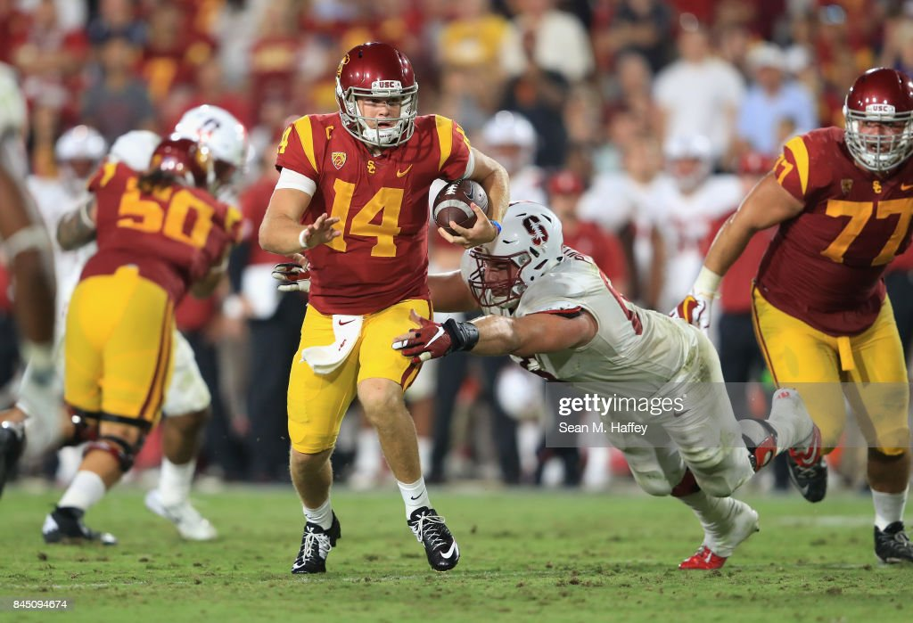 Harrison Phillips #66 of the Stanford Cardinal attempts to tackle Sam Darnold #14 of the USC Trojans during the fourth quarter at Los Angeles Memorial Coliseum on September 9, 2017 in Los Angeles, California.