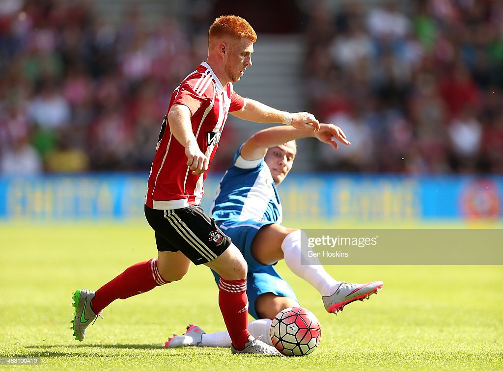 Harrison Reed of Southampton holds off the challenge of Abraham Gonzalez of Espanyol during the pre season friendly match between Southampton and Espanyol at St Mary's Stadium on August 2, 2015 in Southampton, England.