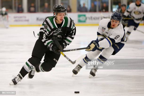 Harrison Roy of the Cedar Rapids RoughRiders skates with the puck against AJ Villella of the Sioux Falls Stampede during the game on Day 2 of the...