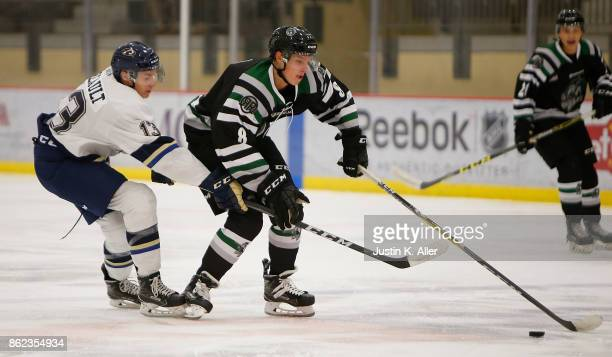 Harrison Roy of the Cedar Rapids RoughRiders skates with the puck against Lucas Breault of the Sioux Falls Stampede during the game on Day 2 of the...