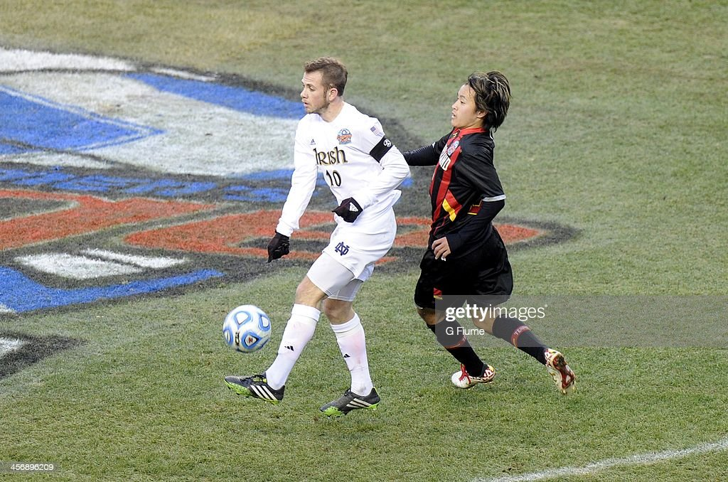 Harrison Shipp #10 of the Notre Dame Fighting Irish handles the ball against Tsubasa Endoh #31 of the Maryland Terrapins during the 2013 NCAA Men's College Cup at PPL Park on December 15, 2013 in Chester, Pennsylvania. Notre Dame won the championship 2-1.