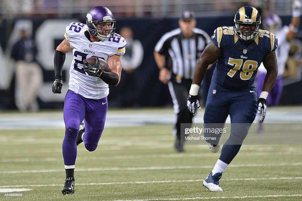 Harrison Smith #22 of the Minnesota Vikings returns and interception for a touchdown in the fourth quarter at the Edward Jones Dome on September 7, 2014 in St. Louis, Missouri. The Vikings defeated the Rams 34-6.