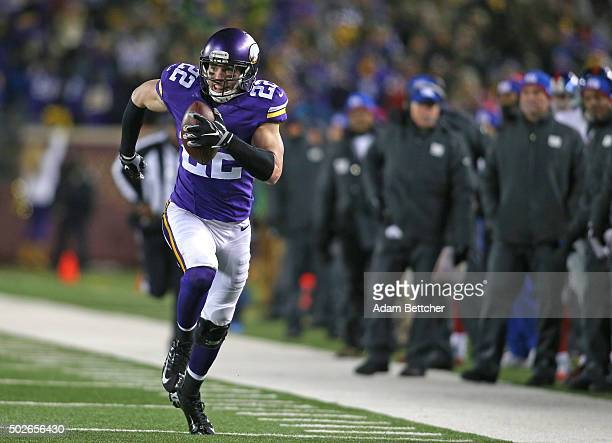 Harrison Smith of the Minnesota Vikings runs in an interception for a touchdown in the second quarter against the New York Giants on December 27 2015...