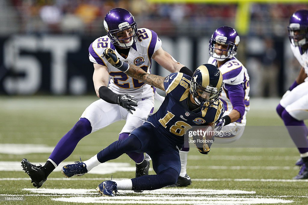 Harrison Smith #22 of the Minnesota Vikings tackles Austin Pettis #18 of the St. Louis Rams during the game at Edward Jones Dome on December 16, 2012 in St. Louis, Missouri. The Vikings won 36-22.