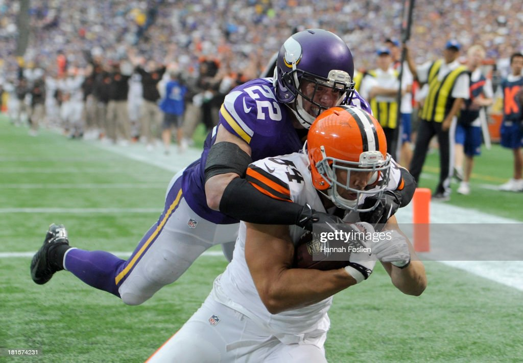 Harrison Smith #22 of the Minnesota Vikings tackles <a gi-track='captionPersonalityLinkClicked' href=/galleries/search?phrase=Jordan+Cameron&family=editorial&specificpeople=5569295 ng-click='$event.stopPropagation()'>Jordan Cameron</a> #84 of the Cleveland Browns after Cameron made a catch for a touchdown during the fourth quarter of the game on September 22, 2013 at Mall of America Field at the Hubert H. Humphrey Metrodome in Minneapolis, Minnesota. The Browns defeated the Vikings 31-27.