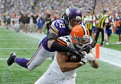 Harrison Smith of the Minnesota Vikings tackles Jordan Cameron of the Cleveland Browns after Cameron made a catch for a touchdown during the fourth...