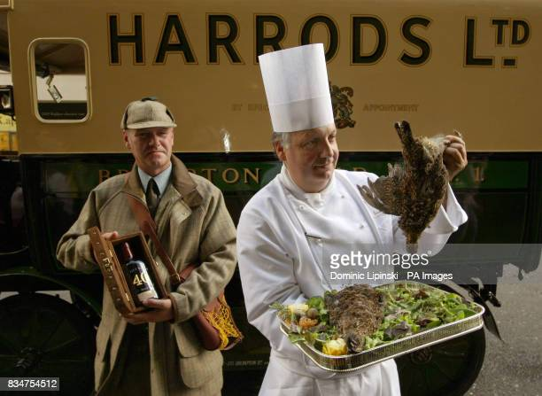 Harrods chef Giuseppe Silvestri inspects the first brace of grouse of 2008 as they arrive at Harrods Knightsbridge London delivered by gamekeeper...