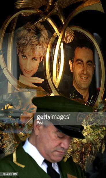 Harrods doorman stands in front of a picture of the late Dodi Fayed and Diana Princess of Wales in Harrords Department Store on August 31 2007 in...