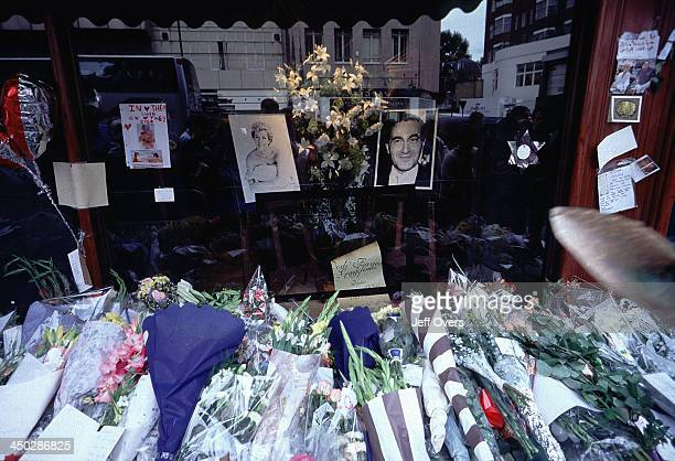 Harrods flowers laid for Diana Princess of Wales and Dodi Fayed Close up of shop window with a picture of Diana and Dodi floral tributes laid in...