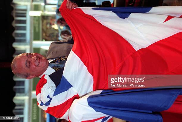 Harrods owner Mohamed Al Fayed wraps himself in a Union Jack flag at the London store The Al Fayed brothers' battle for citizenship now looks set to...