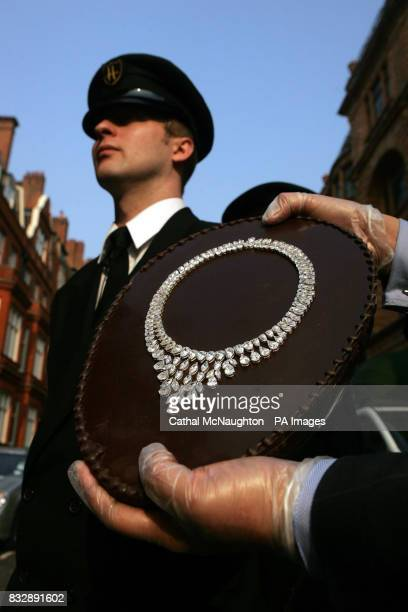 A Harrods security guard watches over a 40cm Belgian dark chocolate halfegg that is set with a necklace made from pear shaped and marquise diamonds