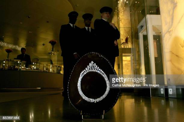 Harrods security guards watch over a 40cm Belgian dark chocolate halfegg that is set with a necklace made from pear shaped and marquise diamonds