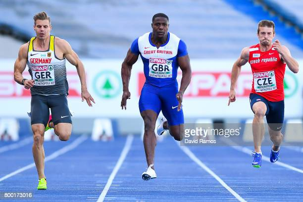 Harry AikinesAryeetey of Great Britain wins past Julian Reus of Germany and Zdenek Stromsik of Czech Republic the Men's 100m heat 1 during day 1 of...