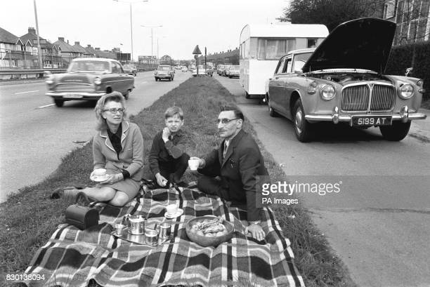 Harry and Frances Gilbert with their nineyearold son Kristy having a picnic on the side of the road The Gilbert family from West Twyford have been...