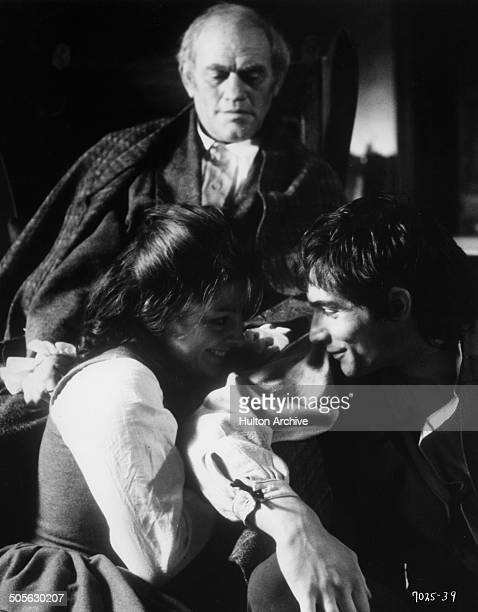 Harry Andrews looks over Anna CalderMarshall and Timothy Dalton as Heathcliff in the movie 'Wuthering Heights' circa 1970