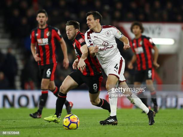 Harry Arter of AFC Bournemouth and Jack Cork of Burnley battle for possession during the Premier League match between AFC Bournemouth and Burnley at...