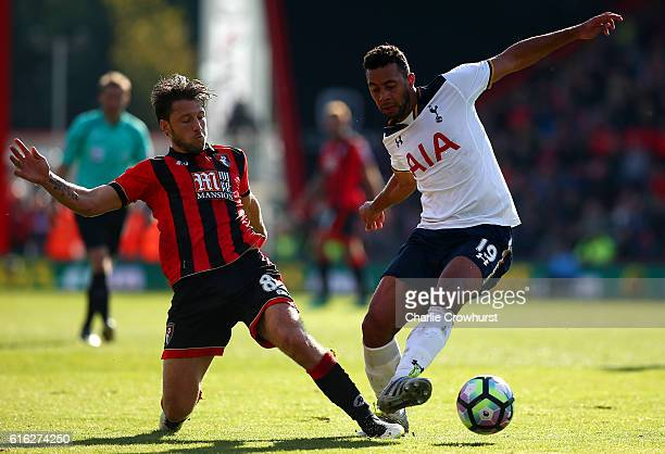Harry Arter of AFC Bournemouth and Mousa Dembele of Tottenham Hotspur battle for possession during the Premier League match between AFC Bournemouth...