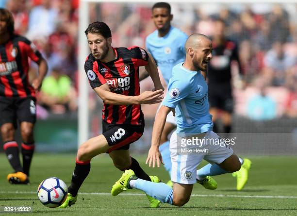 Harry Arter of AFC Bournemouth tackles David Silva of Manchester City during the Premier League match between AFC Bournemouth and Manchester City at...