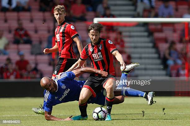 Harry Arter of Bournemouth and Frederic Gounongbe battle for the ball during a preseason match between Bournemouth and Cardiff City at Goldsands...