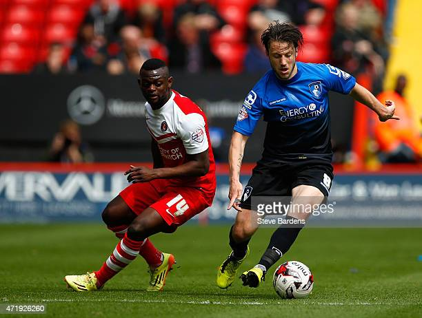 Harry Arter of Bournemouth and Igor Vetokele of Charlton compete for the ball during the Sky Bet Championship match between Charlton Athletic and AFC...