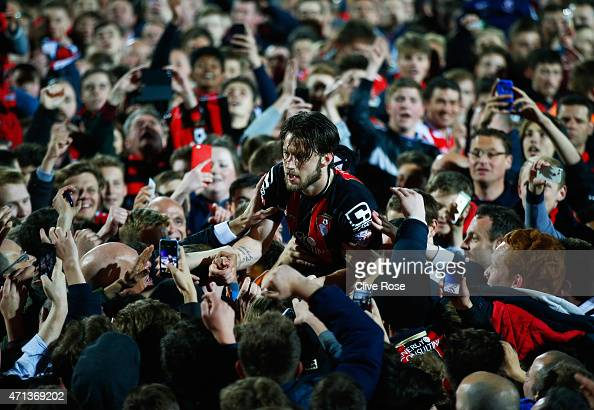 Harry Arter of Bournemouth celebrates victory with fans as they invade the pitch after the Sky Bet Championship match between AFC Bournemouth and...
