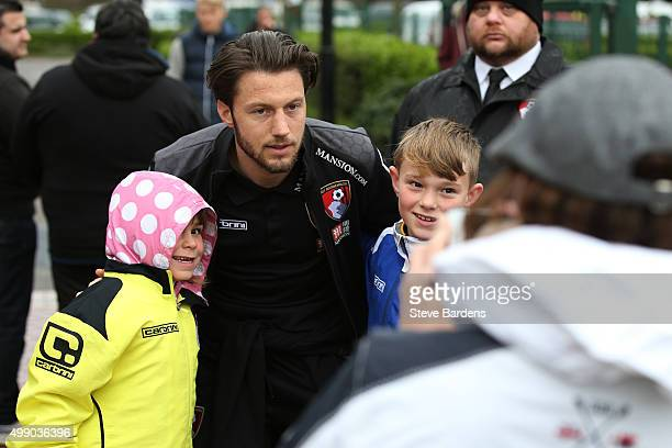 Harry Arter of Bournemouth poses for photographs with fans on arrival at the stadium prior to the Barclays Premier League match between AFC...