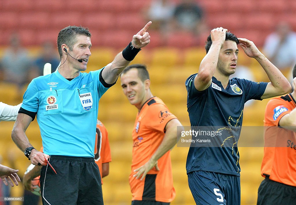 Harry Ascroft of the Mariners is given a red card and sent from the field by referee Matthew Conger during the round 18 A-League match between the Brisbane Roar and Central Coast Mariners at Suncorp Stadium on February 6, 2016 in Brisbane, Australia.