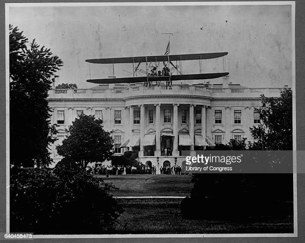 harry Atwood flies an early biplane over the White House lawn July 1911