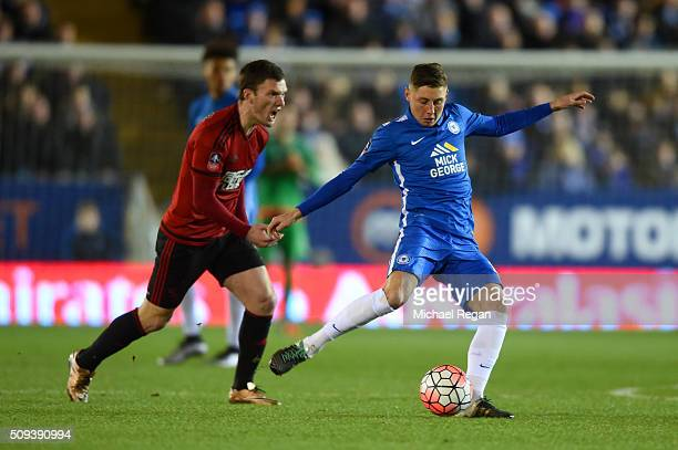 Harry Beautyman of Peterborough passes the ball under pressure from Craig Gardner of West Bromwich Albion during the Emirates FA Cup fourth round...