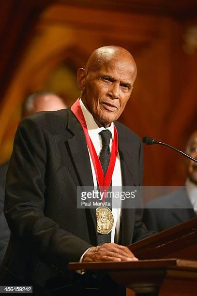 Harry Belafonte receives the WEB Du Bois Medal at Harvard University's Sanders Theatre on September 30 2014 in Cambridge Massachusetts