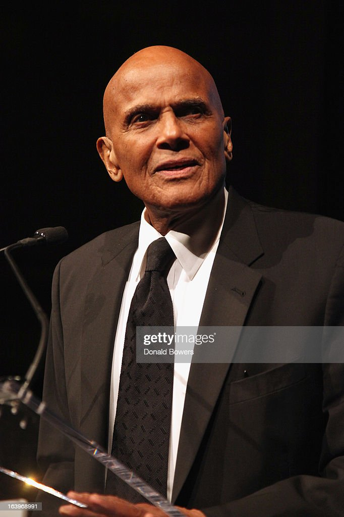 <a gi-track='captionPersonalityLinkClicked' href=/galleries/search?phrase=Harry+Belafonte&family=editorial&specificpeople=204214 ng-click='$event.stopPropagation()'>Harry Belafonte</a> speaks onstage at the Shared Interest 19th Annual Awards Gala on March 18, 2013 in New York City.